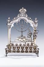 A RARE AND IMPORTANT SILVER CHANUKAH LAMP