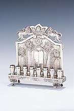 A SILVER CHANUKAH LAMP