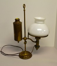 Brass student lamp with milk glass globe.