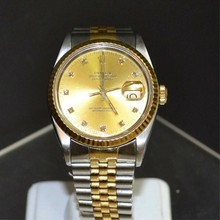 Man's Stainless & 18kyg Rolex Datejust