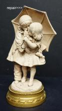 Figurine of Boy & Girl by