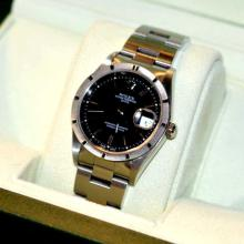Man's Stainless Rolex Date Watch