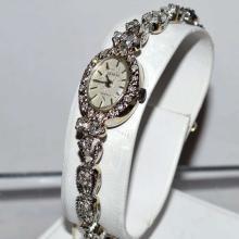 Lady's 14kwg Diamond Geneve Watch 1.50ctw