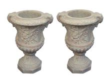 Pair Of Figural Urns