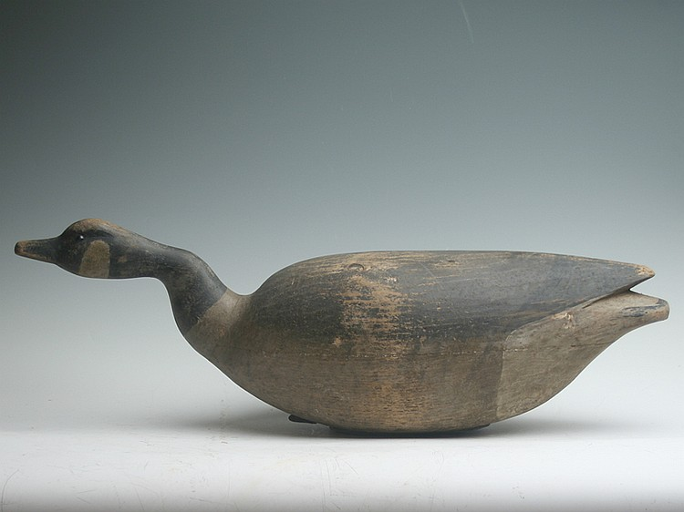 Well made reproduction of a Nathan Cobb swimming goose.