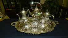 9) Wonderful, antique, heavy silver plated, Poole tea set Lancaster Rose E.P.C.A. 400, with coffee pot, tea pot, creamer & sugar, waste pot, tipping teapot on stand and tray. COND VG-shows light wear from use
