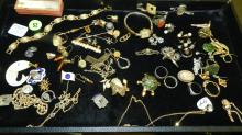 collection of gold and gold plated jewelry, plus others, no tray