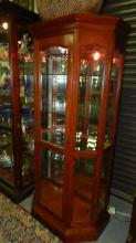 Quality made lighted curio cabinet / display, glass shelving, mirrored back, COND VG. extremely heavy, sturdy construction, special shipping required