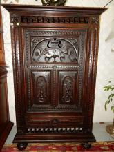 Wonderful antique hand carved German single door cabinet, with bun feet, open gated top, floral and face panel door, original patina, single bottom drawer, overall COND VG, appears back board has been replaced. *Special shipping required