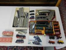 Large vintage German toy train set by Marklin, with engines, cars, track, buildings etc