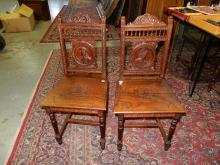 11) 2 piece antique carved Euro side chairs, with deep carved man and woman portrait, carved floral seat, special shipping required