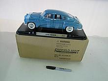1948 Tucker Die Cast Car On Stand. With Box.