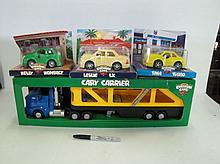 4 Pcs Chevron Cars/Truck. Cary Carrier & 3 Cars. Boxes May Be Dusty.