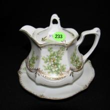 Vintage porcelain RS Prussia creamer with under plate, cond VG
