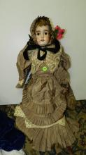 44) Lovely antique bisque head doll, with quality outfit, COND VG. Aprox. 24