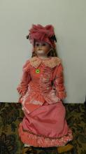 44) Lovely antique bisque head doll, with quality outfit, COND VG. Aprox. 28