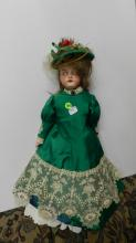 44) Lovely antique bisque head doll, with quality outfit & unique mechanical eyes in head. COND VG Aprox. 23