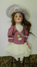 44) Lovely antique bisque head doll, with quality outfit, COND VG. Aprox. 20