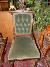 9) Antique carved parlor chair, with portrait crest. Special shipping required