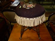 Nice antique needlepoint piano stool with glass ball and claw foot, special shipping required