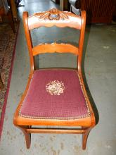 Nice antique carved parlor chair with needlepoint seat. Special shipping required
