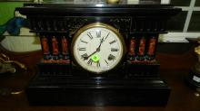 5) Lovely, antique, iron cased mantle clock with pillar design. Heavy-Special shipping required