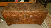 24) Lovely vintage Asian scene carved Camphor wood Japanese blanket chest, with people and village scene, cond VG, special shipping required