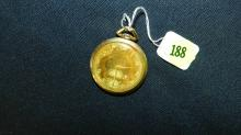 stamped 14KT gold pocket watch, by Tavannes, watch has discolor to face
