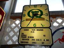 Vintage original lighted service station clock for Quaker State oils, with letter changing reader sign bottom