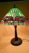 Gorgeous custom made stained glass dragonfly table lamp, with a nice bronze finish base. The emerald shade and dancing ruby dragonflies in the shade are stunning! There is over 250 cut pieces of glass, shade 16