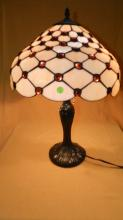 Beautiful custom made stained glass table lamp, featuring large warm golden jewels and a nice bronze finish base. There is over 200 cut pieces of glass, shade 16