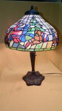 Wonderfully unique custom made stained glass table lamp with a fun Christmas Santa scene set to warm your home and holiday festivities, with a nice bronze finish base. Over 700 cut pieces of glass! shade 16