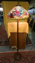 Wonderfully unique custom made stained glass floor lamp with a fun Christmas Santa scene set to warm your home and holiday festivities, with a nice bronze finish base. Over 750 cut pieces of glass! shade 19 3/4