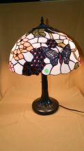 Beautiful custom made stained glass table lamp with fun butterflies, grape clusters & blossoms scattered around the shade and a nice bronze finish base. Over 300 cut pieces of glass! shade 16