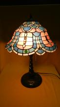 Wonderful custom made stained glass table lamp with subtle pastels and detailed scalloping along with numerous jewels sprinkled throughout & has a nice detailed bronze finish base with circling dragonflies. Over 340 cut pieces of glass! shade 16