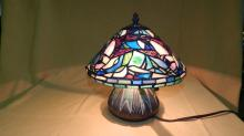 Beautiful unique size, custom made stained glass table lamp with bluebirds and a lovely irredescent glow on the shade & has a nice detailed bronze finish base featuring mosaic tiling and emerging tulip spears rising up. Over 300 cut pieces of glass! shade 10