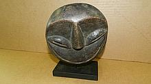 5317) Small Central African carved mask on stand. 7 1/2