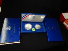 Nice U.S. 2 piece Silver and Half dollar in case Liberty coins 1986