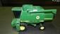 605) die cast vintage toy tractor / combime 9500 John Deere 12
