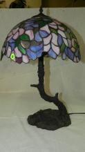Lovely custom designed, stained glass table lamp, with floral shade and unique tree trunk base. COND VG