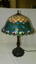 Nice Tiffany Style Peacock Feathers Table Lamp, Few lamps can rival this one for richness of color dramatic styling and aestethic appeal. The peacock tail feather design will intrigue and delight.