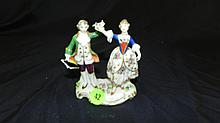 Hand painted porcelain man and woman figurine, possible minor flake to flower, COND VG, 4