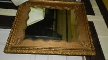45) Antique carved wall mirror