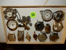 Tray of vintage wrist watches (no bands) various makers, styles, cond