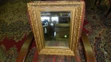 Antique gold painted shadow box style wall mirror