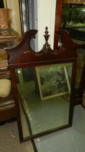 Carved mahogany wall mirror. Special shipping required