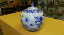 Nice Asian style porcelain blue and white lidded jar with dragon