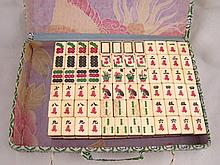 A Chinese Mah Jong set of 144 bone and bamboo