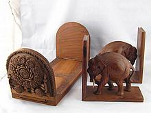 A pair of teak bookends, elephants pushing against