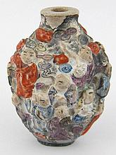 A Chinese ceramic snuff bottle, the surface with
